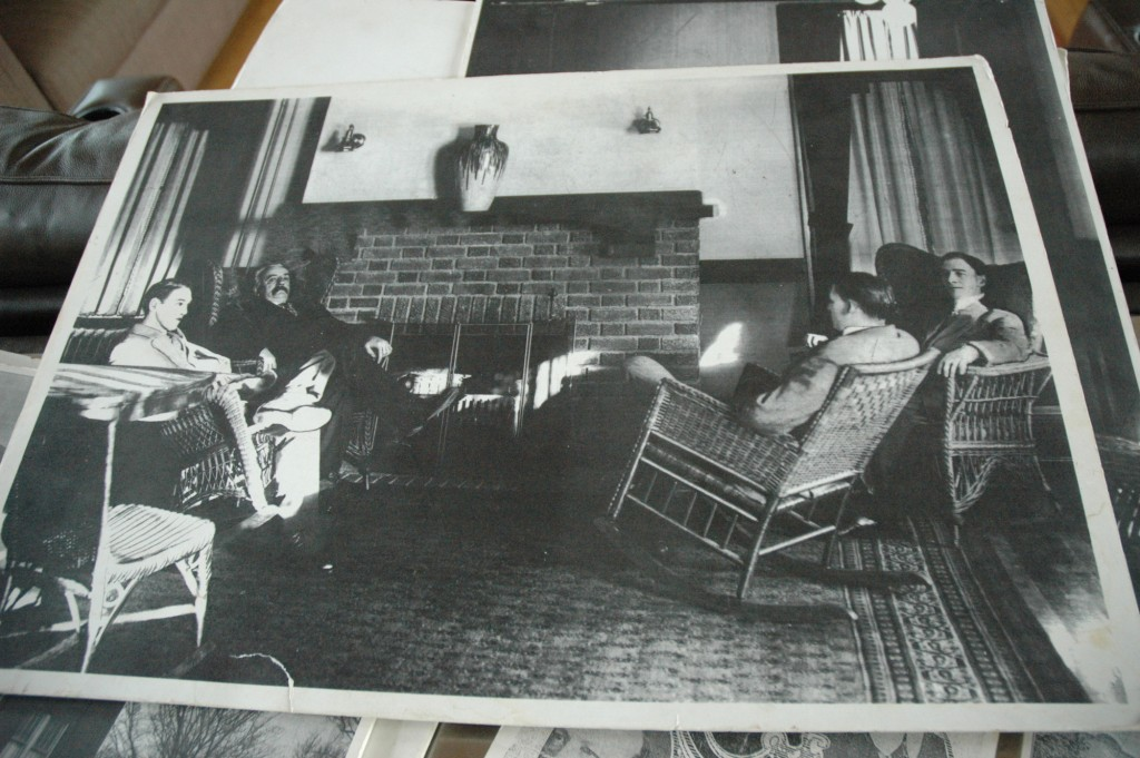 Lake Harriet Commercial Club members sit by a fireplace.